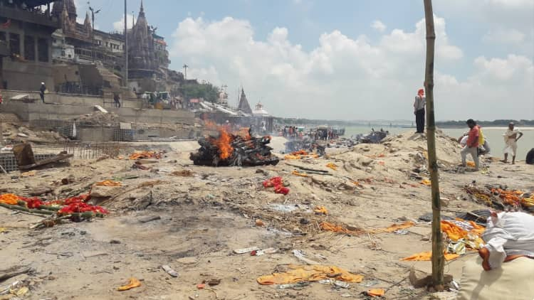 see cremation at one of the burning ghats
